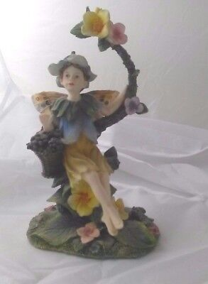 Fruit garden figurine fairy type sitting in a tree bough  by regency fine arts