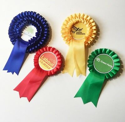 political rosettes Labour Conservative liberal and Green
