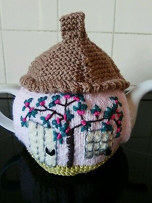 Handknitted pink cherry blossom cottage tea cosy