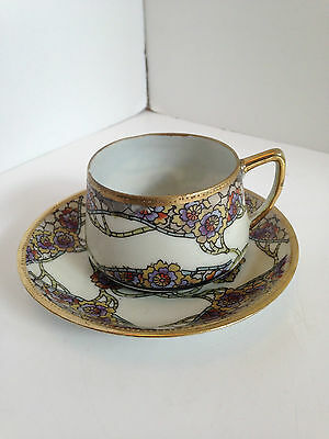 Hand Painted  Tea Cup and Saucer With Gold