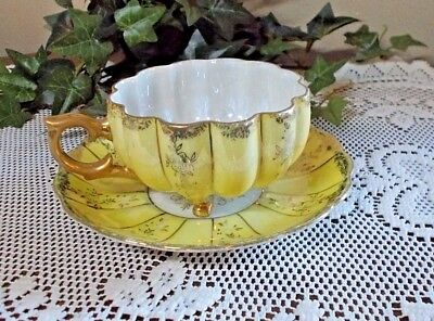 Vintage Decorative Footed Teacup and Saucer White Yellow with Gold Decoration