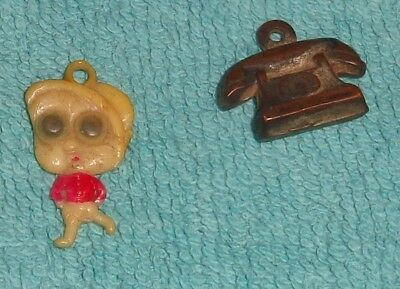 VINTAGE Lot Of Two CELLULOID Phone Bug Eyed Boy CRACKER JACK GUMBALL TOY CHARMS