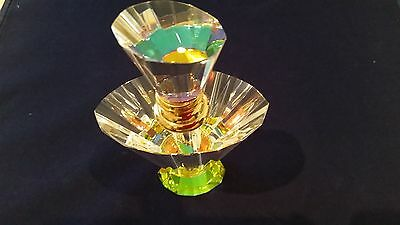 Perfume Bottle With Faceted Reflective Glass Displaying Great Colours.