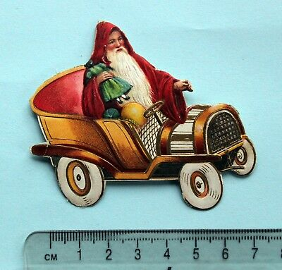Early Die Cut Embossed Scrap Santa  With Doll In Gilded Motor Car