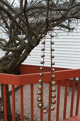 String of (27)  GRADUATED  Vintage brass PETAL style sleigh bells on strap 1800s