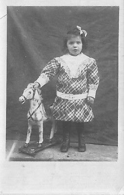 Photo Studio Real Photo Postcard Little Girl with a Toy Hobby Horse~114976