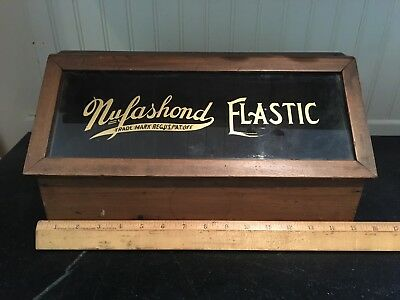 Nufashond Elastic Counter Top Display ~ Walnut & Painted Glass ~ 1920s