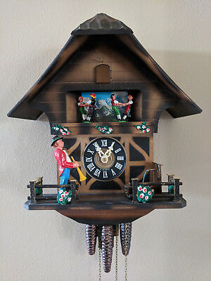 Vintage Musical Cuckoo Clock with Dancing Couples and Horn Player Chalet Style