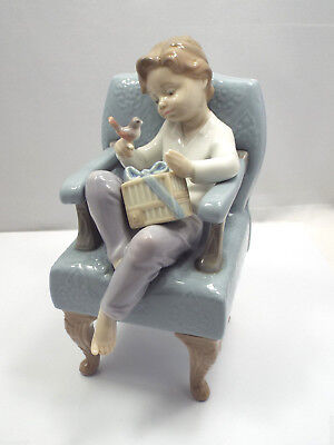 Lladro Figurine #6510 An Unexpected Gift, Boy Sitting in Chair with Bird on Hand
