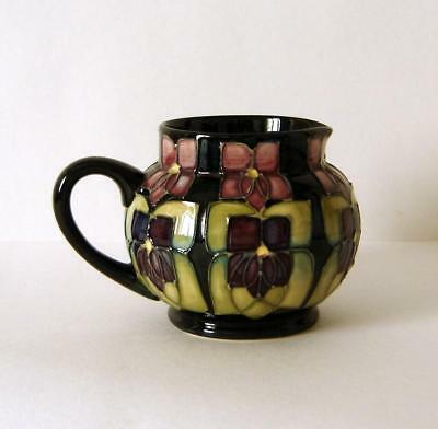 moorcroft black singles Moorcroft history, hints, tips and what to look out for moorcroft was founded as a studio in 1897 by william moorcroft within the james can also be found in black.