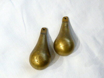Pair of vintage brass pear shaped clock weights. Very heavy