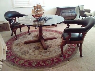 antique dining table and captains chairs