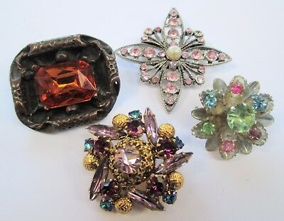 Four vintage brooches (amber glass, gold metal, amethyst paste, pearl etc)