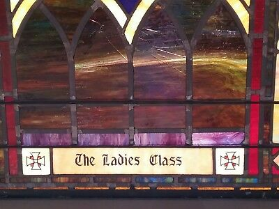 Vintage turn of the century stained glass windows in metal from church .