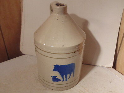 """stoneware jug, cow and calf on the side, one gallon. 11 1/2"""" tall"""