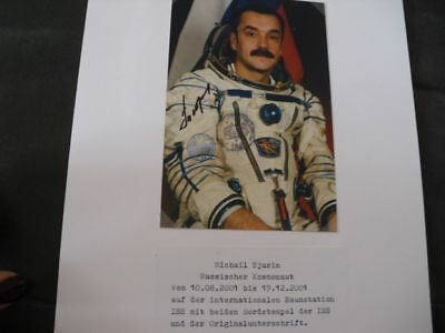 Portraitphoto Tjurin, Photo flown with STS 105 to ISS; SPACE