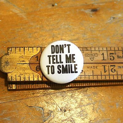 Don't Tell Me To Smile Button Pinback Pin Bottle Opener Keychain Magnet Protest