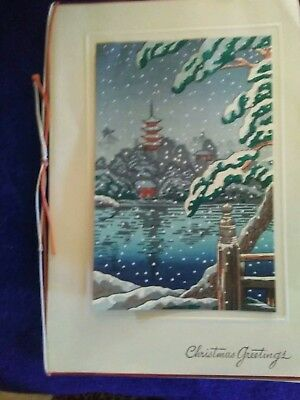 Japanese Vintage Woodblock Print of a pagoda in a snow scene.
