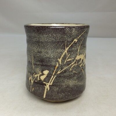 D953: Japanese old SHINO pottery tea cup with good black glaze and bamboo design