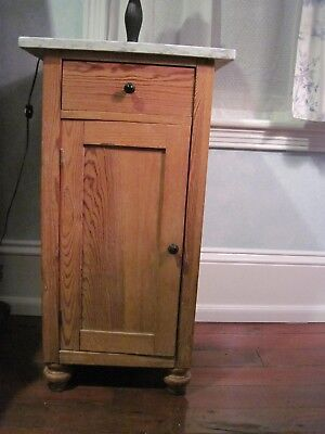 Small pine cabinet with marble top