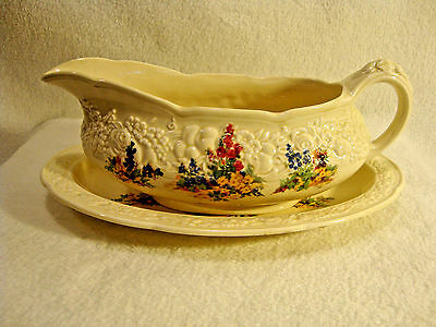 Crown Ducal porcelain china cream color gravy boat in the florentine pattern.