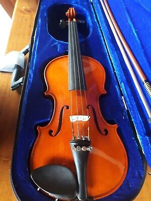 Violin 1/4 size, professionally setup, fiberglass bow, hard case.