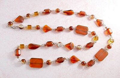 Vintage style long wired glass bead necklace in yellow/brown amber colours