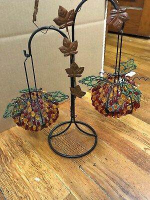 WROUGHT IRON STAND WITH TWO BEADED CANDLE HOLDERS---------------------c2