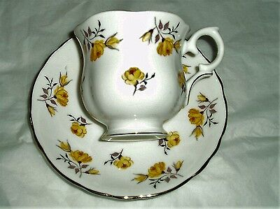 Vintage Crown Staffordshire china teacup and saucer pattern 8910 yellow floral