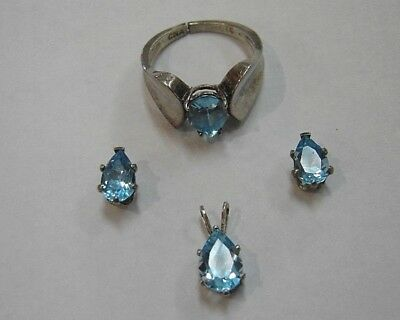 925 Sterling Silver Set of Earrings, Ring, and Pendant with Blue Topaz 505-E