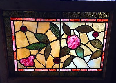 Eastlake floral stained glass transom window