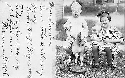 Real Photo Postcard Two Children in Yard with Rolling Hobby Horse & Doll~111313