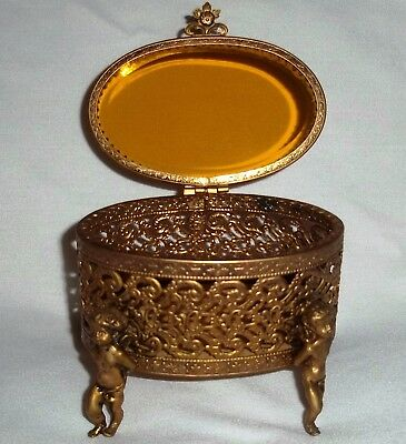 Vintage Oval Brass Ormolu Filigree Jewelry Box Cherub Footed Amber Beveled Glass