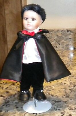 Porcelain Baby Dracula Doll with Stand