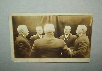 Old antique vtg 1910s Post Card Real Photo Trick Image of Five of Same Man Table