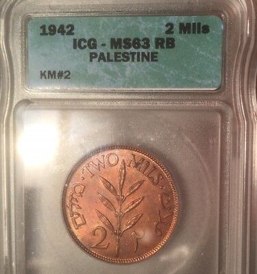 Beautiful toned Palestine 2 Mils 1942.  KM #2. Nice even golden color. ICG 63 RB