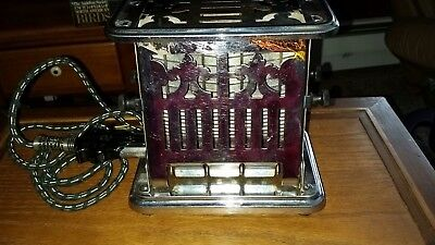 Antique Universal Landers, Frary, & Clark Flip Side Toaster  No. E 7213A  Works
