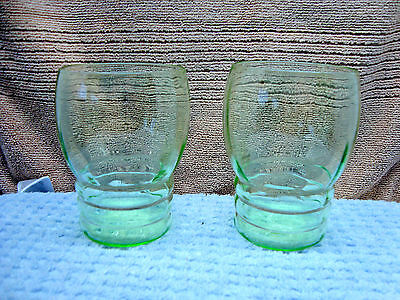 237 Two green vaseline glass juice glasses.
