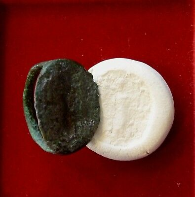 bronze roman seal ring of a God / Goddess standing holding a lyre