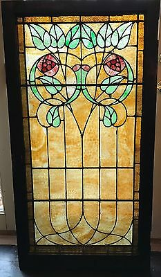 Antique stained glass landing window featuring roses