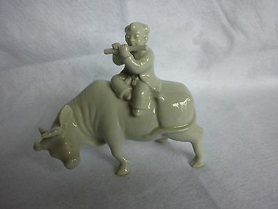 Vintage Porcelain Man Riding an Ox Playing a Flute