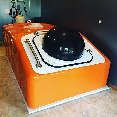 "Used Floatation Tank, 2017 Escape Pod ""Aphelion"" in Orange."