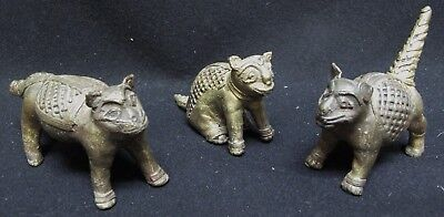 Set of Three Antique Brass over Bronze Indonesian Lion Dog Figurines