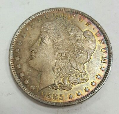 Under Wholesale Bid- 1885 O Toned Choice Bu Morgan Silver Dollar
