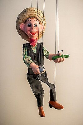 Marionette Mexican-style cowboy w/straw hat, pistol, bottle, stereotype