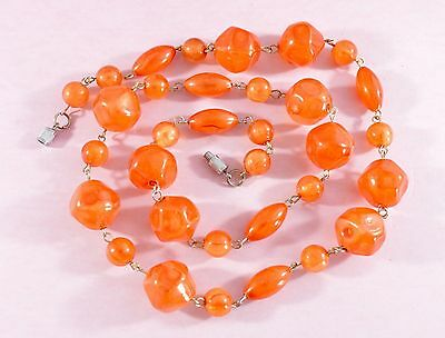 Vintage vibrant wired orange early plastic/lucite/celluloid bead necklace