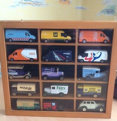 Model car display cabinet, glass fronted, complete with 15 vehicles