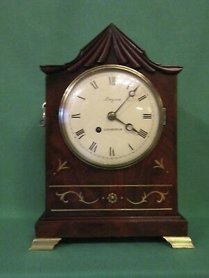 Regency period mahogany and brass inlay bracket timepiece