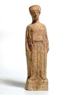 Greek Boeotian pottery statuette of a woman standing: Circa 5th century BC.