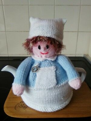 Handknitted nurse tea cosy with  watch